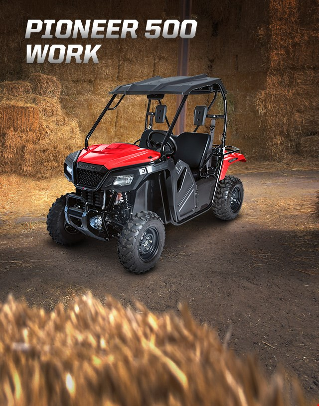Pioneer 500 Work. Adventures anywhere. Compact side-by-side parked in hay barn
