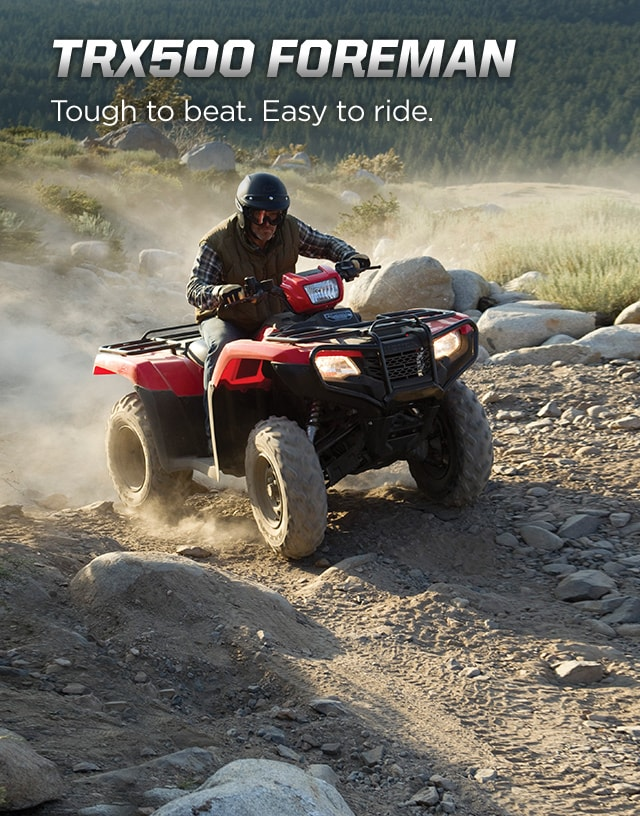 TRX500 Foreman. Tough to beat. Easy to ride. Image of tough ATV rider driving up rugged terrain with a trail of dust behind.