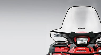 ATV Parts & Accessories. Add more to do more of what you love. Image of windshield on front of red ATV