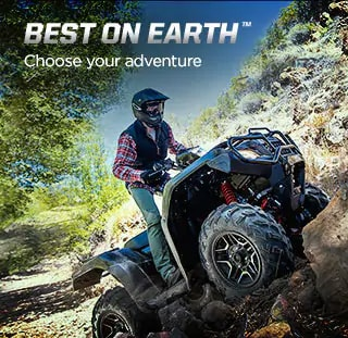 Best on Earth. Choose your adventure. Image of ATV rider in black helmet in standing position climbing over big boulders