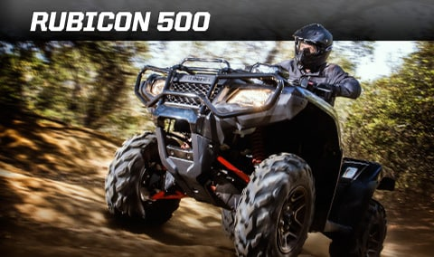 Image Of Rider On Black ATV Comfortably Driving On Wooded ATV Trail ...