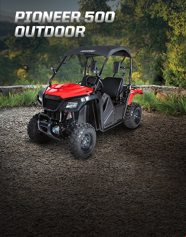 Pioneer 500 Outdoor. Adventures anywhere. Side-by-side parked on large gravel patio overlooking  lush green woodland