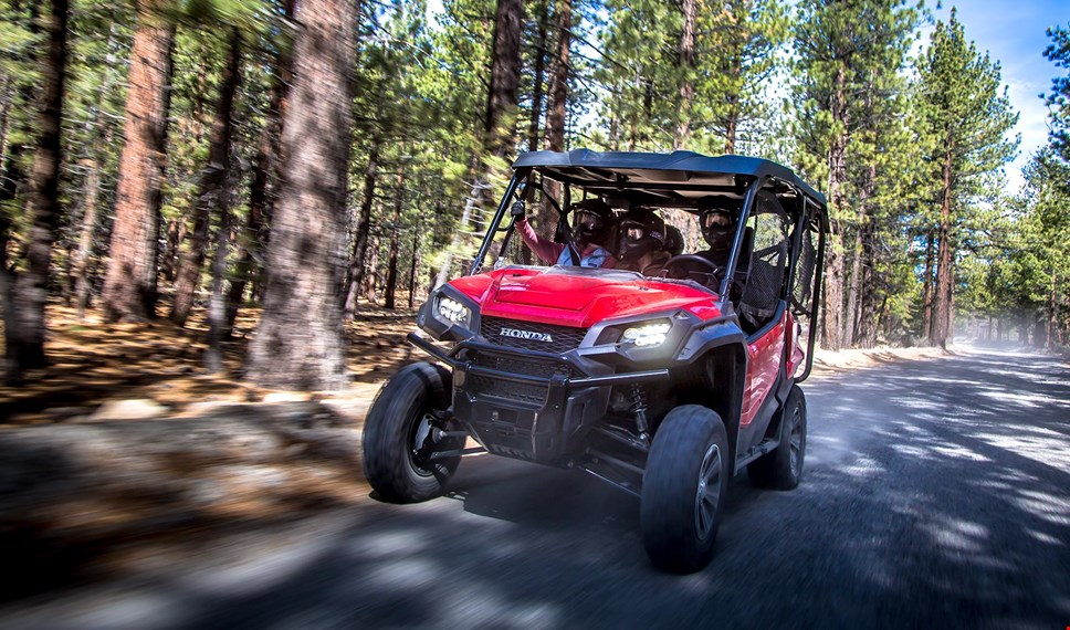 The Pioneer 1000-5's large, rugged aluminum wheels and 27-inch radial tires on craggy terrain
