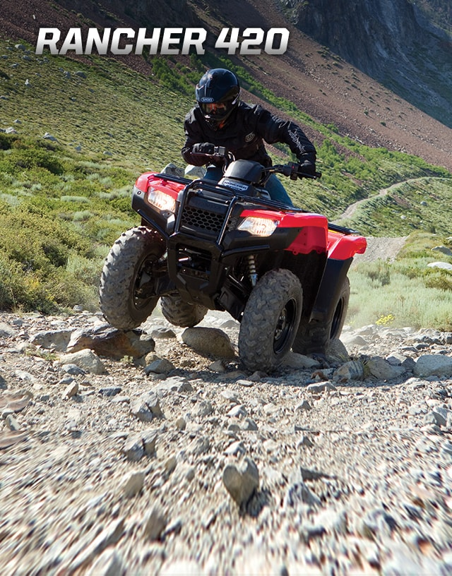 TRX420 Rancher. Modest size, bold personality. Image of rider on ATV manouevering over large rocks on a rugged trail incline.