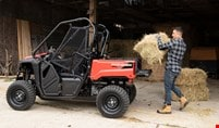 Farmer putting hay in the tilt box