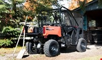 Pioneer 520 with tools for yard work