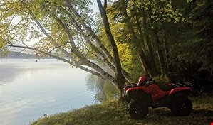 ATV parked in front of pond